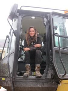 Emily Gorham sits in her excavator.