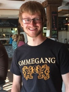 Tom Poole wearing an Ommegang shirt