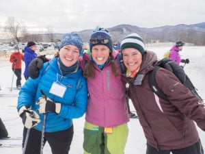 Three Ladies posing together in the snow with cross-country ski gear