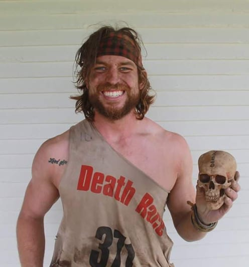 Submitted Eric Hutterer, 25, claimed a record at the Death Race for his barbed wire crawl.