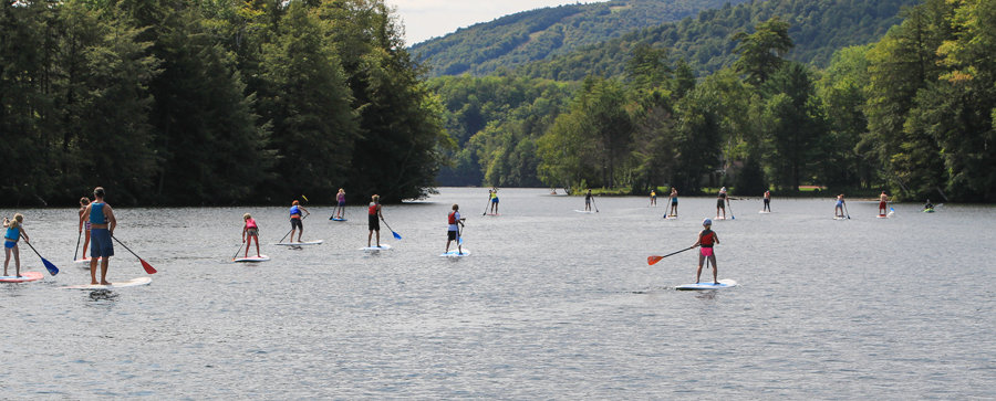 Courtesy First Stop Board Barn Paddlers of all ages took to the waters of Woodward Reservoir in a unique type of race – paddleboarding.