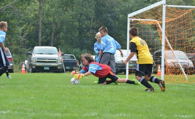 Elementary soccer teams vie for possession