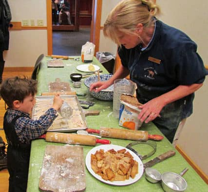 A youngster learns what to do with leftover piecrust at Billings Farm & Museum.