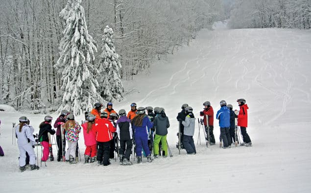 Skiers and riders enjoy powder opening day at Pico
