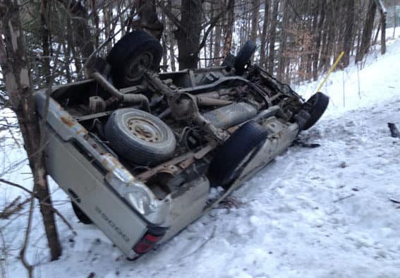 Teen rolls truck, escapes injury