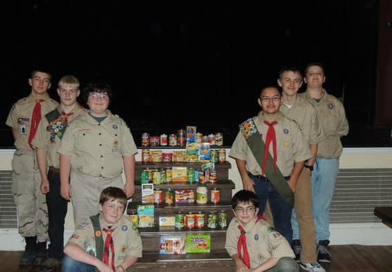 Scouts helping their neighbors in need through a Court of Honor food drive