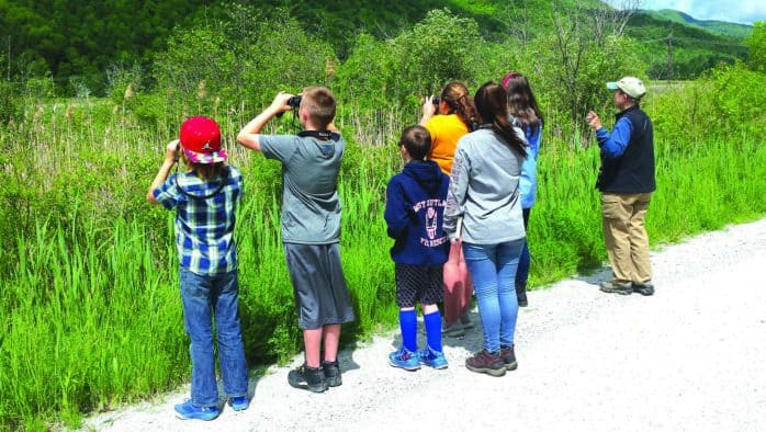 Fifth-graders go to marsh for hands-on education
