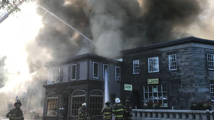 Fire guts historic building, businesses