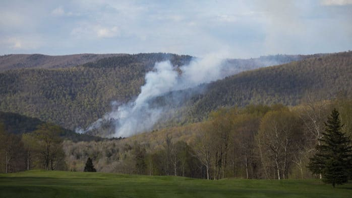 Killington forest fire continues to smolder