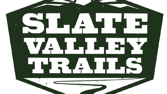 Looking to its future, Slate Valley Trails logo reflects past